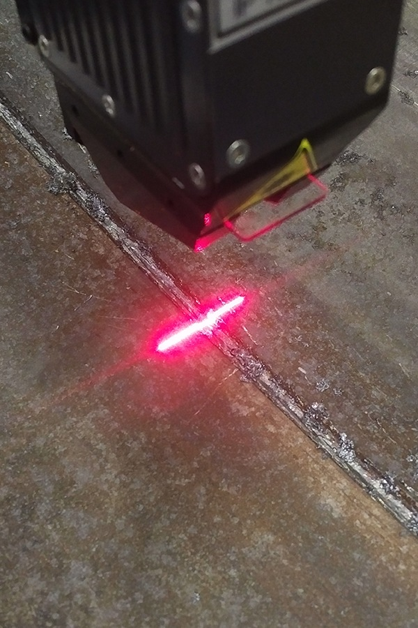 Smart laser sensor finding defects in a weld